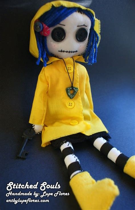 Coraline rag doll, with plenty of buttons and blue hair